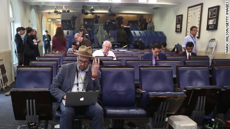 WASHINGTON, DC - FEBRUARY 24:  New York Times reporter, Glen Thrush works in the Brady Briefing Room after being excluded from a press gaggle by White House Press Secretary Sean Spicer, on February 24, 2017 in Washington, DC. The New York Times, Los Angeles Times, CNN and Politico were also excluded from the off camera gaggle. (Photo by Mark Wilson/Getty Images)