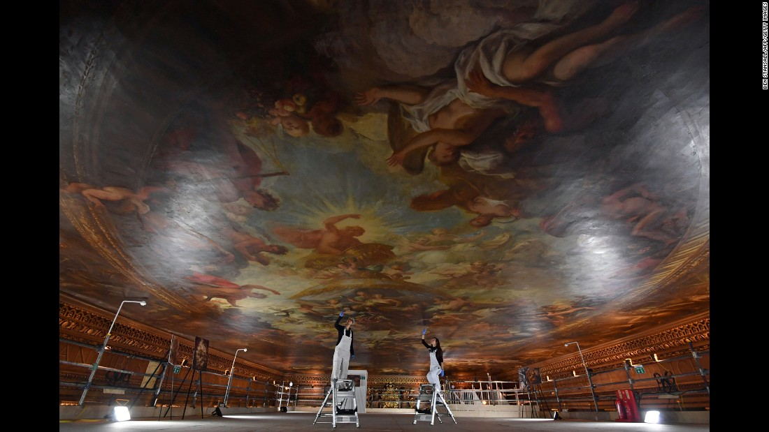Conservators in London pose for a photo Thursday, March 30, as they promote the restoration project of the Painted Hall ceiling at the Old Royal Naval College. Over the next two years, conservators will work on the ceiling, which was painted between 1707 and 1726 by artist James Thornhill.