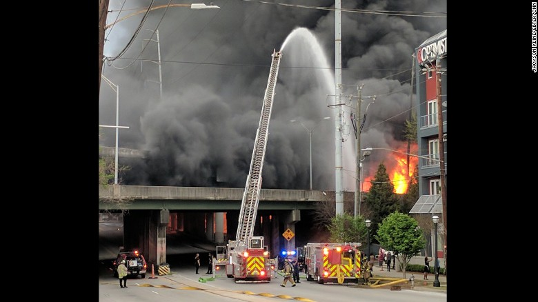 Firefighters on March 30 battle the fire that eventually led to the collapse of part of I-85 in northeast Atlanta.