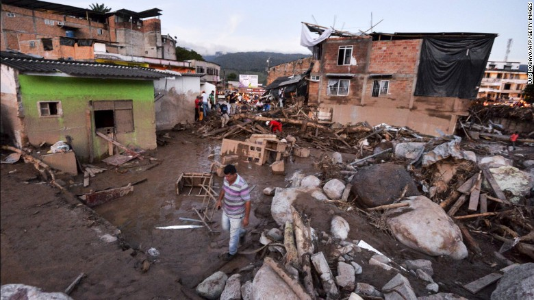 Many people searched through the debris for their possessions after the mudslide destroyed their homes.