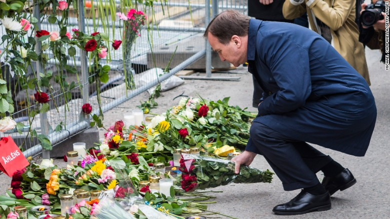 Swedish Prime Minister Stefan Lofven visits the scene of the attack on Saturday, April 8. On Friday, a truck crashed in front of a Stockholm department store, killing four people and injuring more than a dozen others.