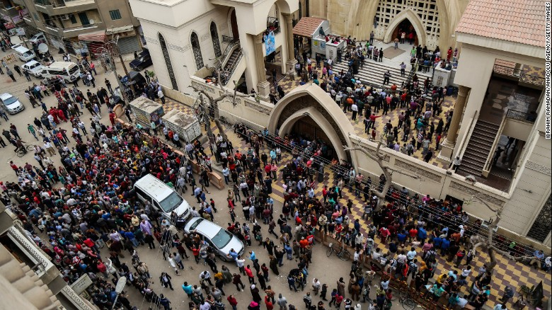People gather in front of St. George's Church after the bombing.