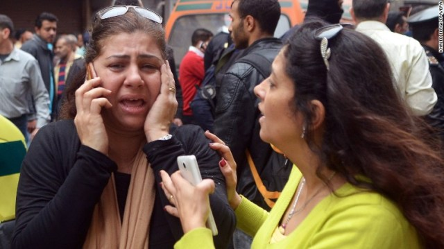 Women try to reach loved ones after the attack in Alexandria.