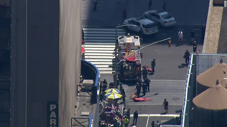 Authorities scramble Thursday after a car crashes into a crowd in New York's Times Square.