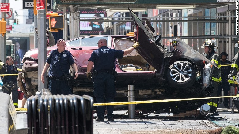 A wrecked car sits in the intersection of 45th and Broadway in Times Square after an accident.
