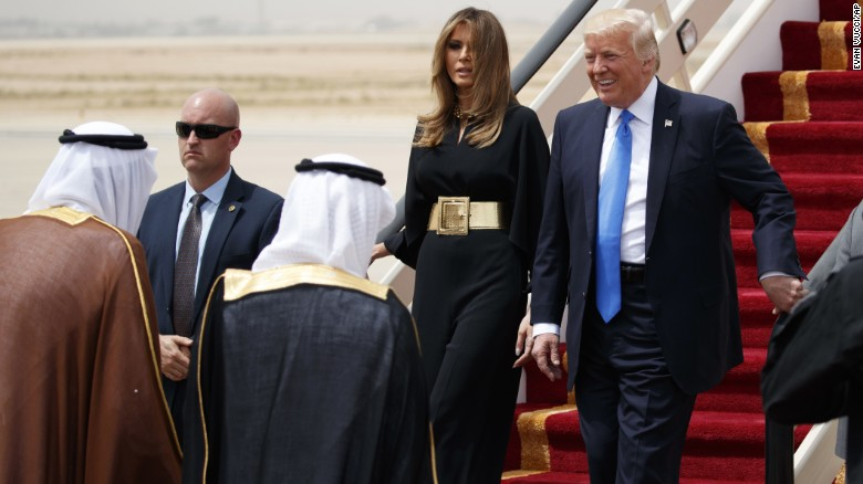 President Trump, accompanied by first lady Melania Trump, smiles at Saudi King Salman at a welcome ceremony Saturday at the Royal Terminal of King Khalid International Airport.