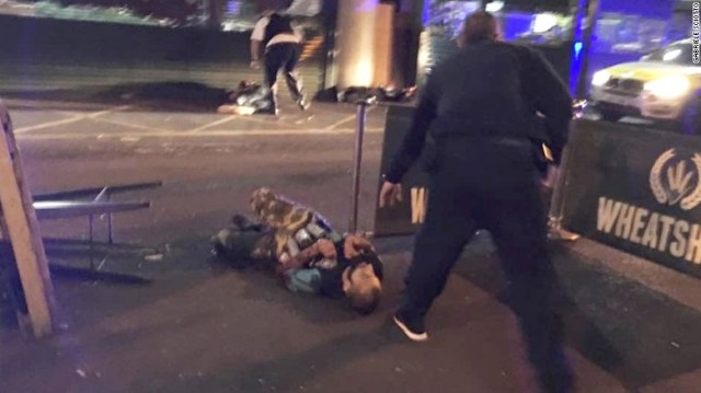 "This image from London's Borough Market shows two people lying on the road. On Saturday, June 3, a van mowed down pedestrians as it sped down London Bridge, leaving bodies lying in the roadway, a witness to the incident <a href=""http://us.cnn.com/2017/06/03/europe/london-bridge-incident/index.html"" target=""_blank"">told CNN</a>. A witness said two people were stabbed at nearby Borough Market. London police are treating both incidents as terror-related."
