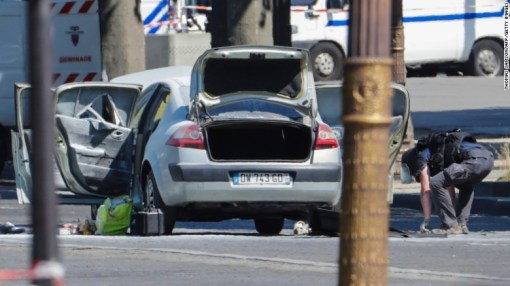A bomb disposal police officer checks a car in a sealed off area on the Champs-Elysees avenue in Paris on Monday.