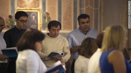 Miguel Alves and his wife, Fatima, sing in the choir of their Portuguese community church.