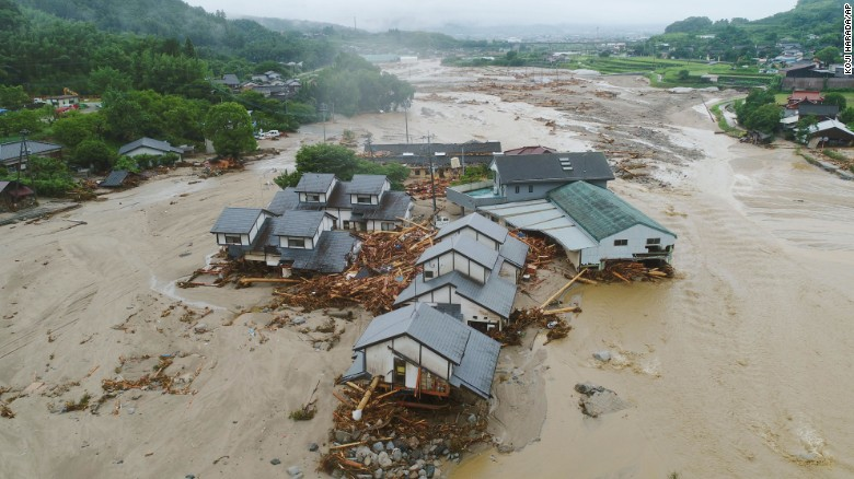 Collapsed houses are half-buried in  mud following the flooding caused by heavy rain in Asakura, Fukuoka prefecture, southwestern Japan.
