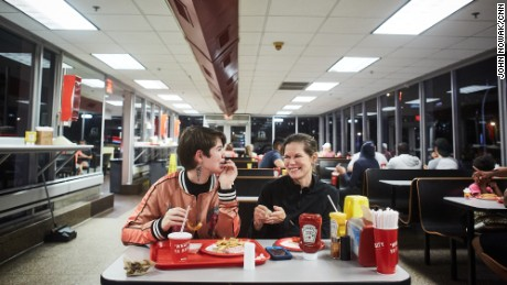 Lillian DeJean, 15, and her mother, Nicole, have dinner at The Varsity during a pit stop in Atlanta.