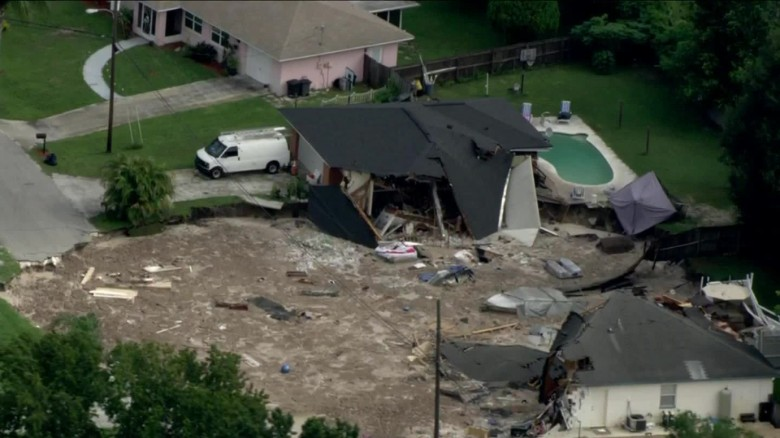 A sinkhole in Land O' Lakes, Florida, swallowed two homes and forced the evacuation of nine others.