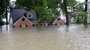 Floodwater engulfs a home in Spring, Texas.
