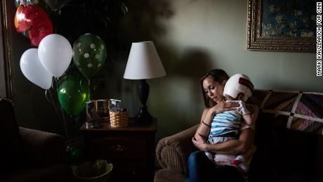 Nicole McDonald comforts her crying son, Jadon, who was frightened by the family dog.