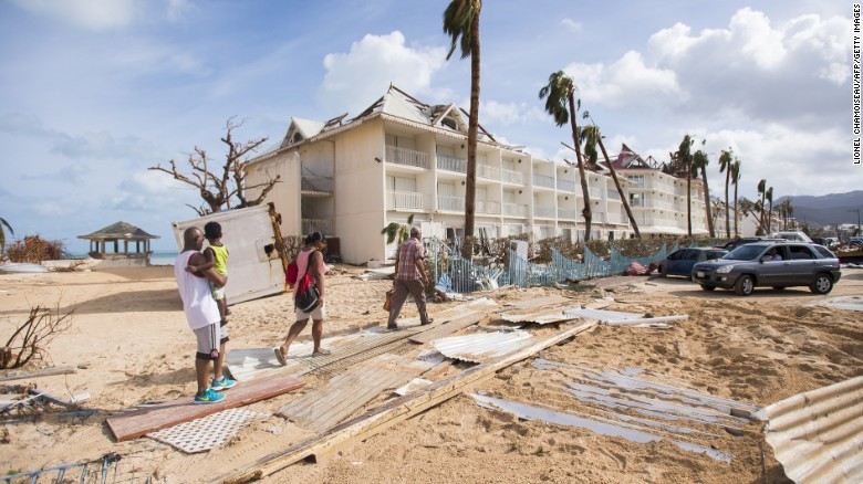 People walk through damage in Marigot, St. Martin, on Thursday, September 7. Hurricane Irma has devastated several islands in the Caribbean.