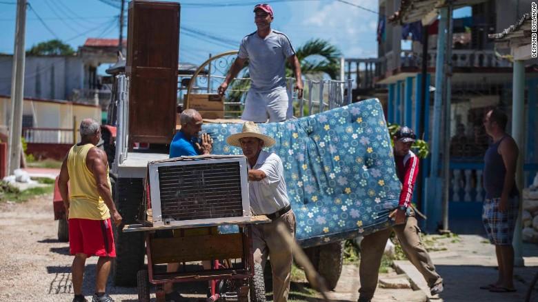 People secure their belongings Thursday ahead of Hurricane Irma in Caibarien, Cuba.