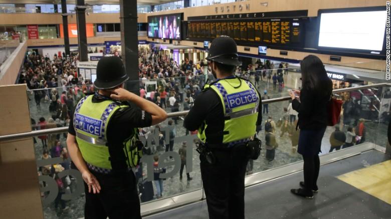 British Transport Police monitor activity Saturday at Euston Station in London.