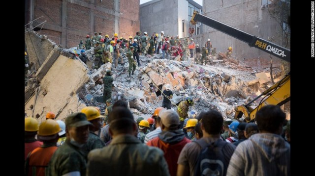 People look for survivors in Mexico City on September 20.