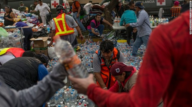 Volunteers organize donations in Mexico City on September 20.