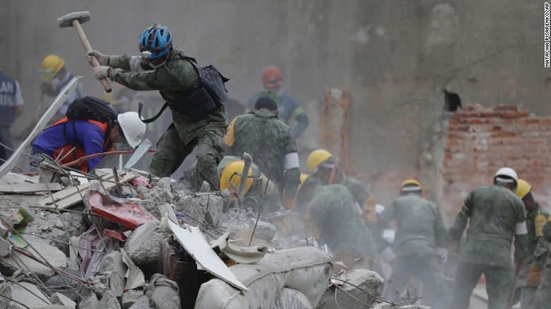 Rescue workers search for survivors Thursday, September 21, at a collapsed apartment building in Mexico City.