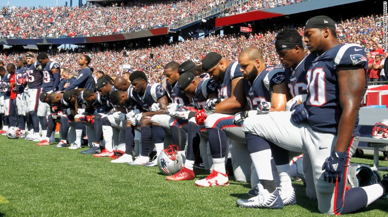Members of the New England Patriots kneel during before a game against the Houston Texans.