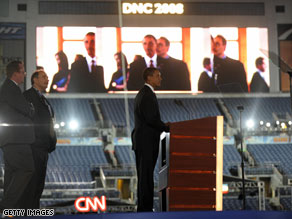Sen. Barack Obama takes a walkthrough of Invesco Field at Mile High on Wednesday night.