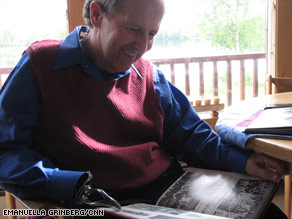 Dr. Curt Menard, Gov. Sarah Palin's family friend and childhood dentist, looks over her high school yearbook.