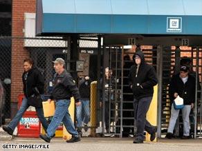 Workers leave a General Motors Powertrain plant last week.