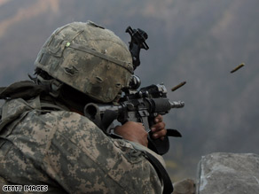 A U.S. soldier fires at Taliban targets during a battle in eastern Afghanistan last month.