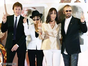 Beatles Paul McCartney, left, and Ringo Starr, right, with Yoko Ono and Olivia Harrison.
