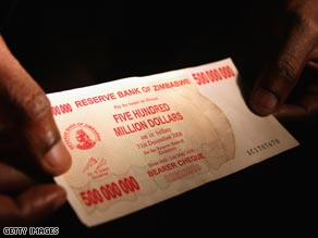 A shopper displays a $500 million Zimbabwean bank note.