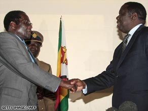 Robert Mugabe (left) and Morgan Tsvangirai met last month for the first round of talks.