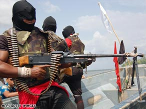 Rebels brandish their weapons in a show of strength for reporters in the Niger Delta.