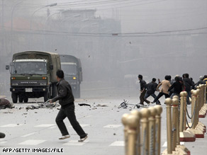 Tibetans stone army vehicles in Lhasa after violent protests broke out in March.