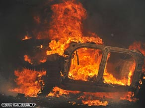 A Georgian armored personnel carriers burns on the road from Gori to Tbilisi.