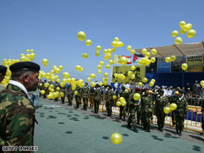 Hezbollah fighters prepare to receive bodies returned from Israel in Naqoura, Lebanon, on Wednesday.