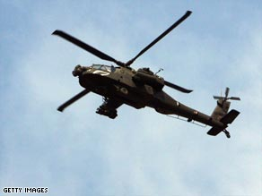 A U.S. army Apache helicopter flies over southern Baghdad, Iraq.
