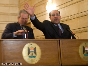 President Bush, left, ducks a thrown shoe as Iraqi Prime Minister Nuri al-Maliki tries to protect him Sunday.