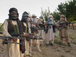 Taliban militants hold their weapons