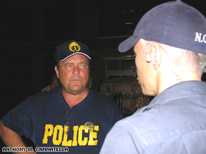 Anderson Cooper on patrol with the New Orleans Police Department and Chief Anthony Cannatella during Hurricane Katrina.