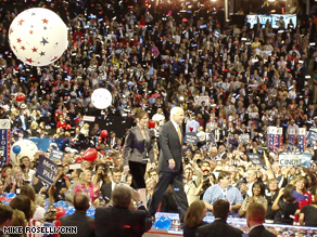 McCain and Palin greet the convention hall.
