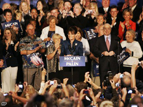 Republican vice presidential candidate Alaska Gov. Sarah Palin, center, introduces Republican presidential candidate Sen. John McCain, Monday, during a rally in Kansas City, Missouri.