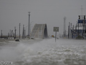Water blows over a roadway as the effects of Hurricane Ike are seen in Surfside Beach, Texas.
