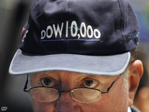 Trader Arthur Cashin wears a 'Dow 10,000' hat, one that was given out when the Dow Jones Industrial Average first hit 10,000 on March 29, 1999, as he works on the NYSE trading floor Monday.