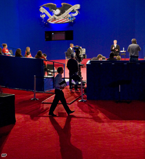 A stagehand casts a long shadow during a rehearsal for the presidential debate.