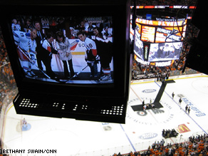 The view from the press box as Sarah Palin posed with members of the Philadelphia Flyers and New York Rangers.
