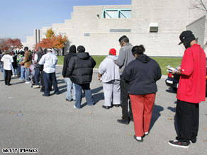 Michigan residents stand in line waiting to vote in the presidential election at the Coleman Young Community Center in Detroit.