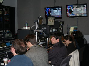 Richard Morris, second from left, in an election night control room.