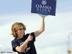 Diane Padolsky flashes a thumbs-up to a passing motorist in rural Colorado.