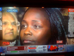Anna Otieno watches Barack Obama's acceptance speech in Chicago's Grant Park.